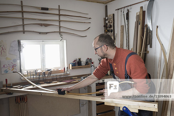 Male bow maker making bow in workshop  Bavaria  Germany