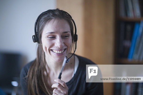Young woman smiling and talking on headset