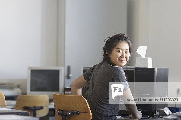 Young female engineer working on computer in an office  Freiburg im Breisgau  Baden-Württemberg  Germany