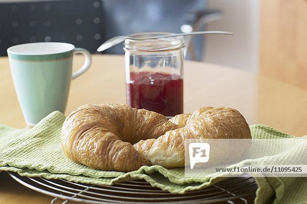 Two croissants with marmalade served in breakfast  Freiburg im Breisgau  Baden-Württemberg  Germany
