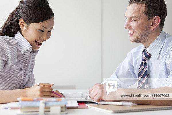 Young Man Teaching Young Woman