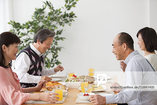 Four Mature People Having Lunch