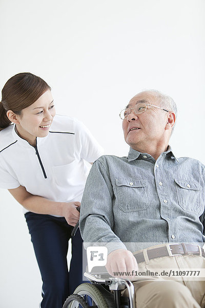 Female Nurse with Senior Male Patient