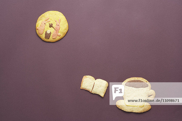 Cookies of rabbits on moon  coffee and book