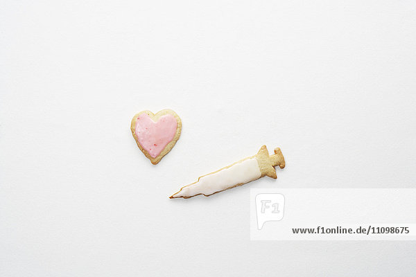 Cookies of heart and syringe