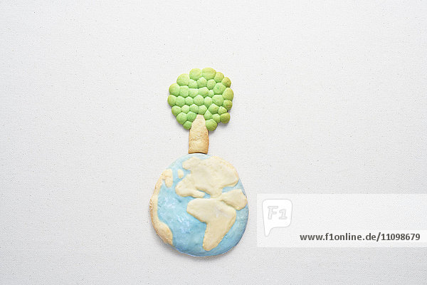 Cookies of planet earth and tree