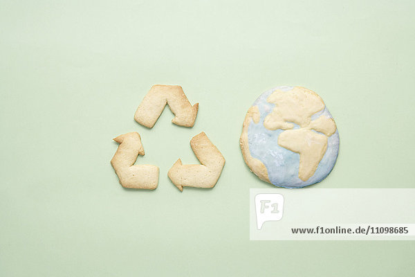Cookies of recycling symbol and planet earth