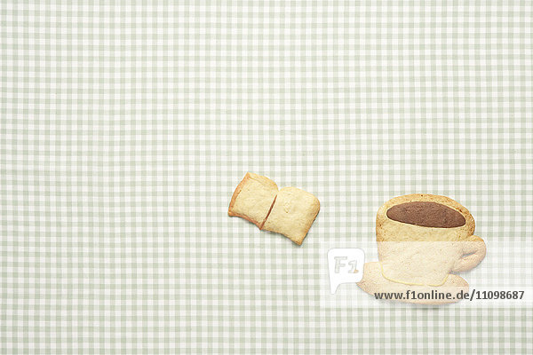 Cookies of book and coffee cup
