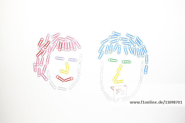 Woman and man made out of paper clips