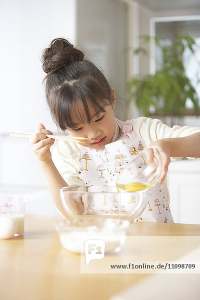 Girl beating egg
