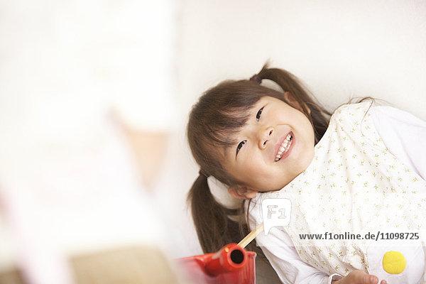 Girl wearing apron smiling