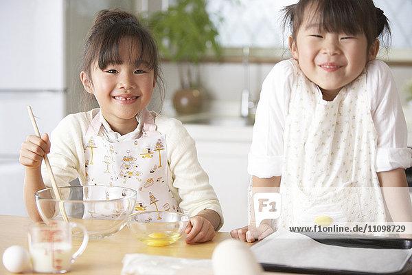 Portrait of girls wearing apron