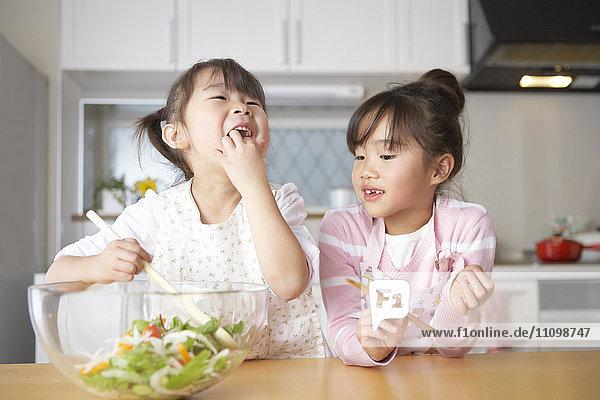 Girls making salad