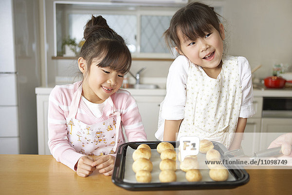 Girls looking at baked bread