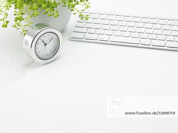 Computer keyboard and clock