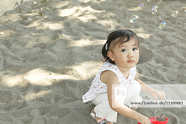 Baby Girl Playing With Sand