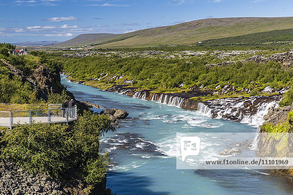Hraunfossar  a series of waterfalls pouring into the Hvita River  Borgarfjordur  western Iceland  Polar Regions