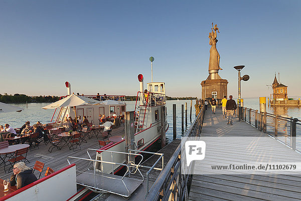 Statue of Imperia by Peter Lenk at the seaport  restaurant on a ship  Konstanz  Lake Constance  Baden-Wurttemberg  Germany  Europe