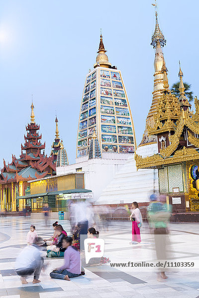 Devotees paying obeisance at the Shwedagon pagoda complex in Yangon (Rangoon)  Myanmar (Burma)  Southeast Asia