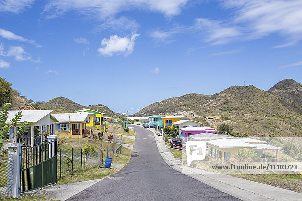 Colorful houses of a village on a spring sunny day  Montserrat  Leeward Islands  Lesser Antilles  West Indies  Caribbean  Central America