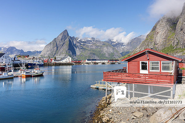 Fishing village and harbour framed by peaks and sea  Hamnoy  Moskenes  Nordland county  Lofoten Islands  Arctic  Northern Norway  Scandinavia  Europe