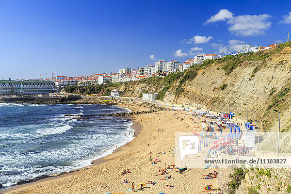 Top view of the village of Ericeira with the ocean waves crashing on the touristic sandy beach  Mafra  Portugal  Europe