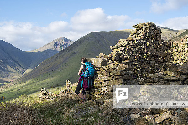 Crumbling stone houses in the English Lake District in Wast Water with views of Kirk Fell and Great Gable in the distance  Lake District National Park  Cumbria  England  United Kingdom  Europe