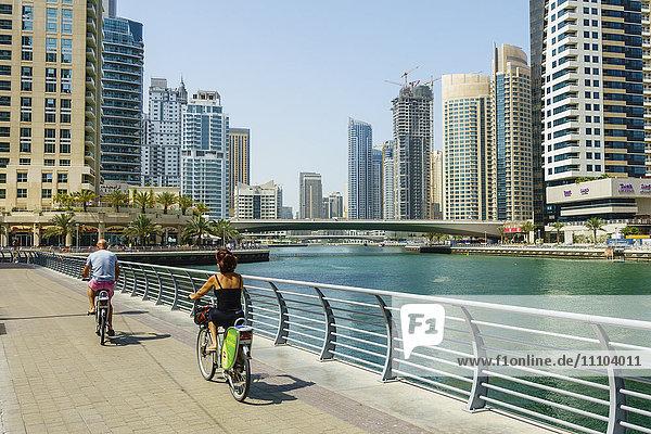 Cyclists on Marina Walk  Dubai Marina  Dubai  United Arab Emirates  Middle East