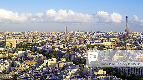 City  Arc de Triomphe and the Eiffel Tower  viewed over rooftops  Paris  France  Europe