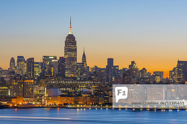 New York skyline with Midtown  Manhattan and Empire State Building viewed across Hudson River  New York  United States of America  North America
