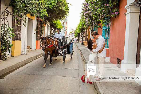 Couple posing in the street  Old Walled-in City  Cartagena  Colombia  South America