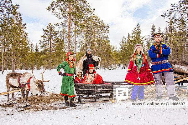 Group photo wearing Traditional Sami costumes,  Reindeer Safari,  Kakslauttanen Igloo Village,  Saariselka,  Finland,  Scandinavia,  Europe