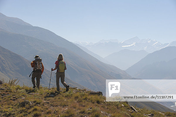 Trekkers make their way east down the Juphal Valley in Lower Dolpa in west Nepal  Himalayas  Nepal  Asia