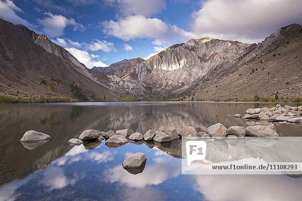 Mountain reflections in Convict Lake in the Eastern Sierras  California  United States of America  North America