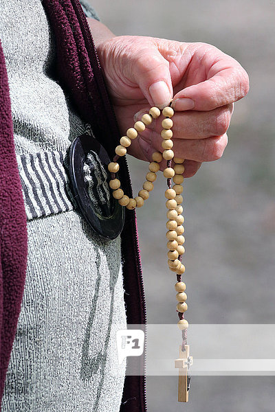 Hand-carved Roman Catholic rosary beads  woman praying The Mystery of the Holy Rosary  Haute Savoie  France  Europe