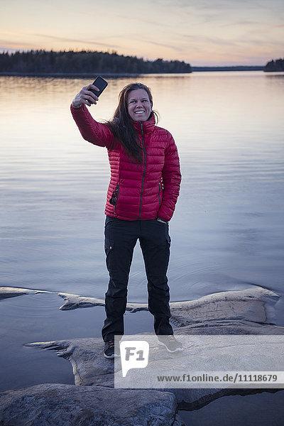 Woman taking selfie at sunset