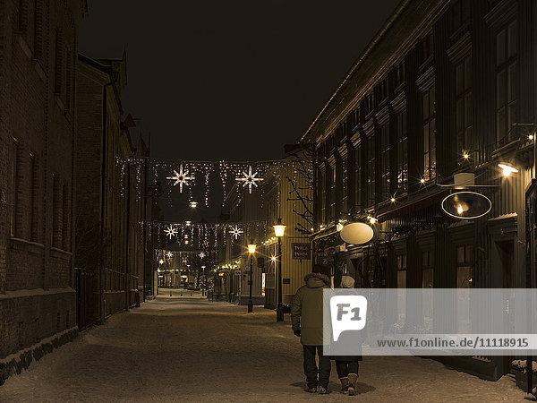 Couple on winter street at night