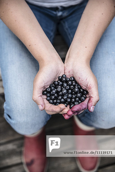 Hands with blueberries