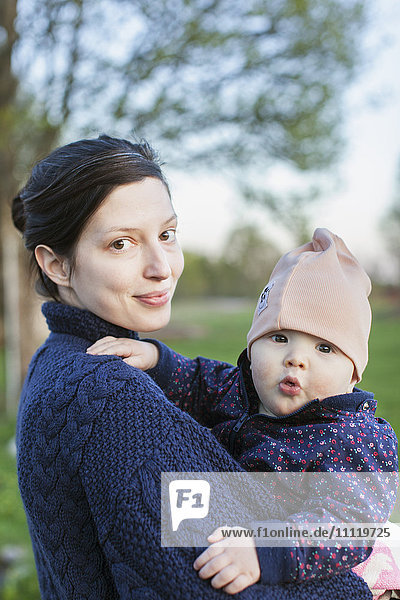 Sweden  Smaland  Mother holding son (6-11 months)