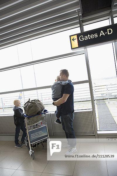 Germany  Hamburg  Mature man and boys (6-7  8-9) at airport