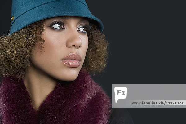 Mixed Race woman wearing hat