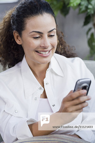 Dominican woman looking at cell phone