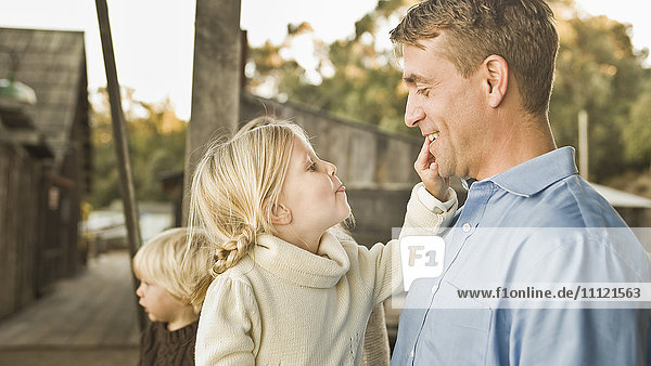 Caucasian father and children outdoors Caucasian father and children outdoors