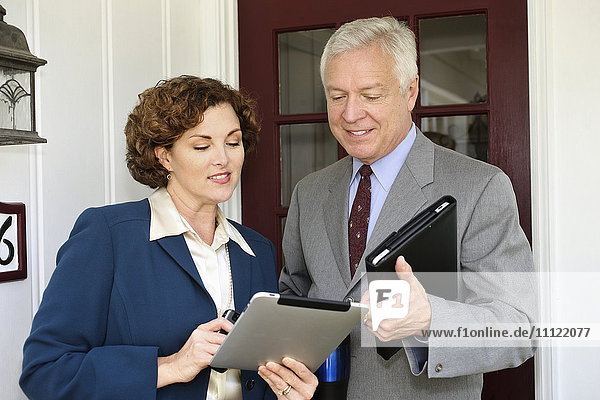 Business people using tablet computers