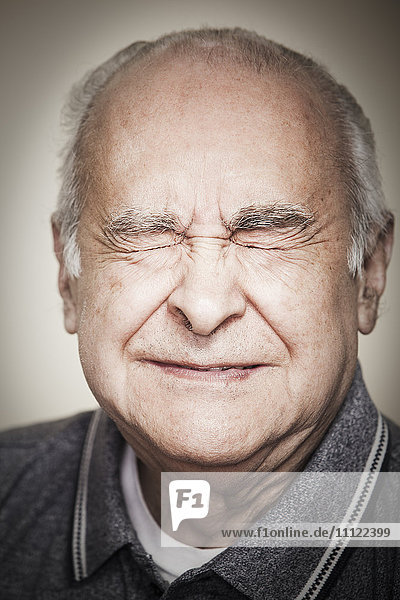 Senior Hispanic man with eyes closed Senior Hispanic man with eyes closed