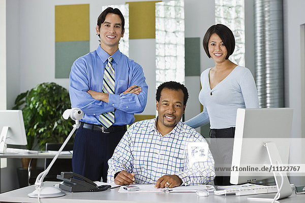 Multi-ethnic co-workers working in office