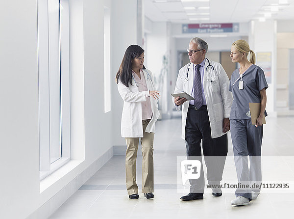 Doctors and nurse talking in hospital