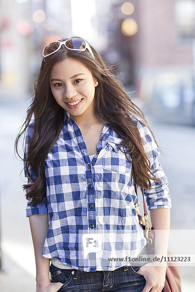 Chinese woman with hands in pockets