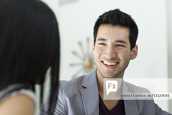 Man smiling at girlfriend