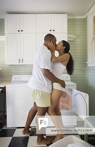Couple wearing underwear and kissing